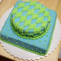 Blue & Green Fun This was my first stacked cake. I had some fondant left over in blue from my Wilton course 3 package cake and decided to make this cake....