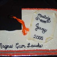 Jerry's Graduation Another one from the beginning when my husband got his masters. Freehand piping was horrible...and hasn't improved much. This is a red...