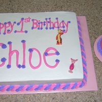 Pooh Birthday Cakes My niece's 1st Birthday cakes. Large cake has pooh figurines and the smash cake has a FBCT.