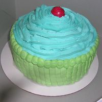 Cupcake A HUGE CUPCAKE. I got a request for this cake and it turned out cute. A few months later Wilton came out with this snazzy cakepan that is 2...