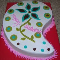 Paisley I used the large Wilton Paisley cake pan for this cake. Covered in buttercream and the decorations are fondant.