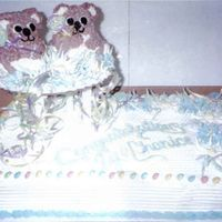 "Twins! I made this cake for a friend having twins. I used a half sheet pan and Wilton's mini 3-d bear pan.The ""rattles are lolli-pops!"