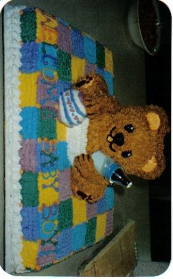 Baby Bear On A Blankie I made this cake for a good friends baby shower using a half sheet pan and Wiltons 3-d bear pan.