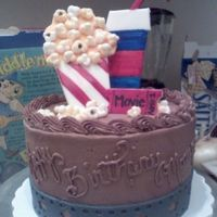 121573359258643.jpg YELLOW CAKE - CHOC BC FROSTING - WITH MMF PIECES.