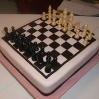 Chris's Chessboard Groom's Cake This is my first official Groom's cake for a very good friend who is a genius at chess so I told him I would love to make him one for...