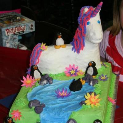 Unicorn Cake With A Penguin On It's Back
