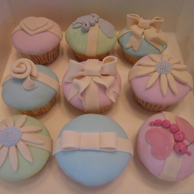 Fondant Covered Cupcakes With Assorted Decorations
