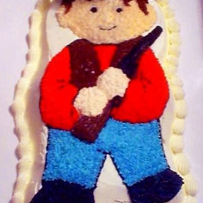 Cowboy With Rifle Shaped Cake