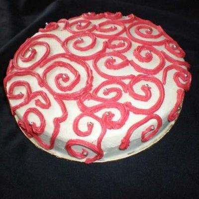 White & Red Scrollwork Cake