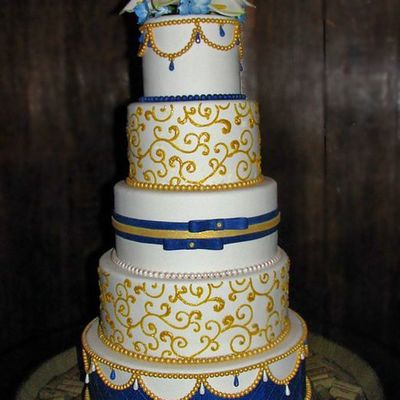 White Blue And Gold Wedding Cake