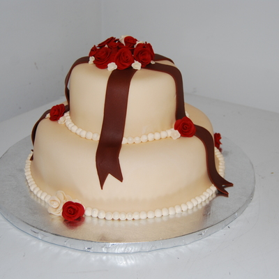 Ivory Cake With Brown Ribbon And Red/ivory Roses