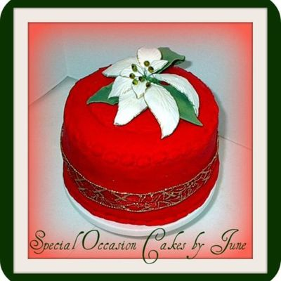 Red Christmas Cake With White Poinsettia