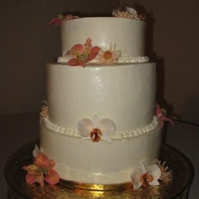 Buttercream Cake With Alstromerias, Mums, And Phaleonopsis Orchids on Cake Central