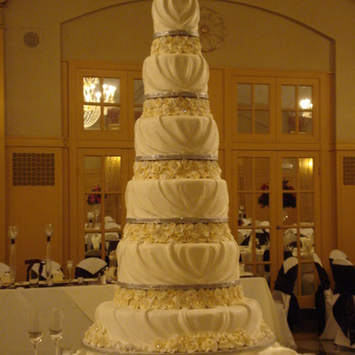 Buttercream Draped Six Tier Wedding Cake