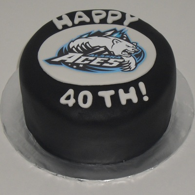 Aces Hockey Puck Cake
