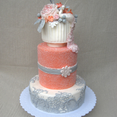 Coral Wedding Cake With Peacock Topper