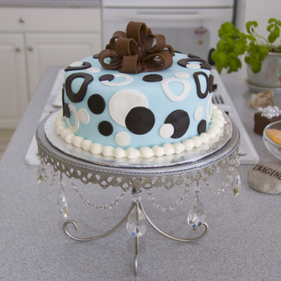 Chocolate Bow On Blue Round Cake With Dots