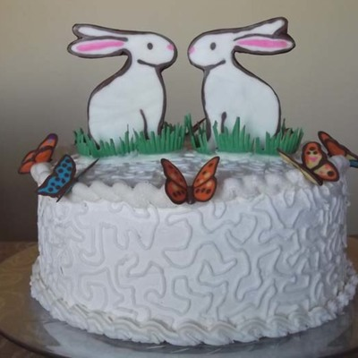 Easter Cake With Chocolate Bunnies And Butterflies
