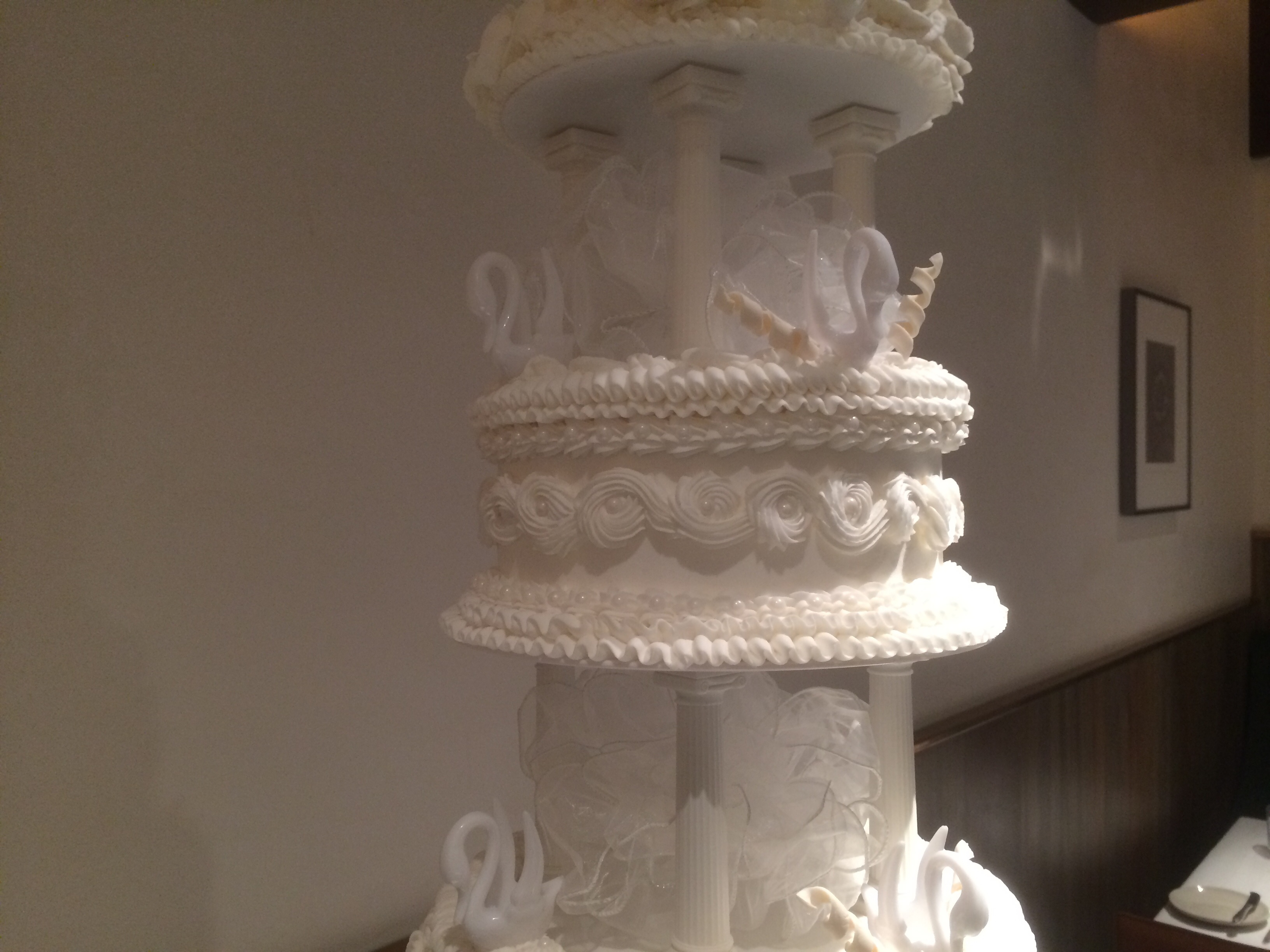 1970 s Style Tiered Wedding Cake With Pillars And Bows
