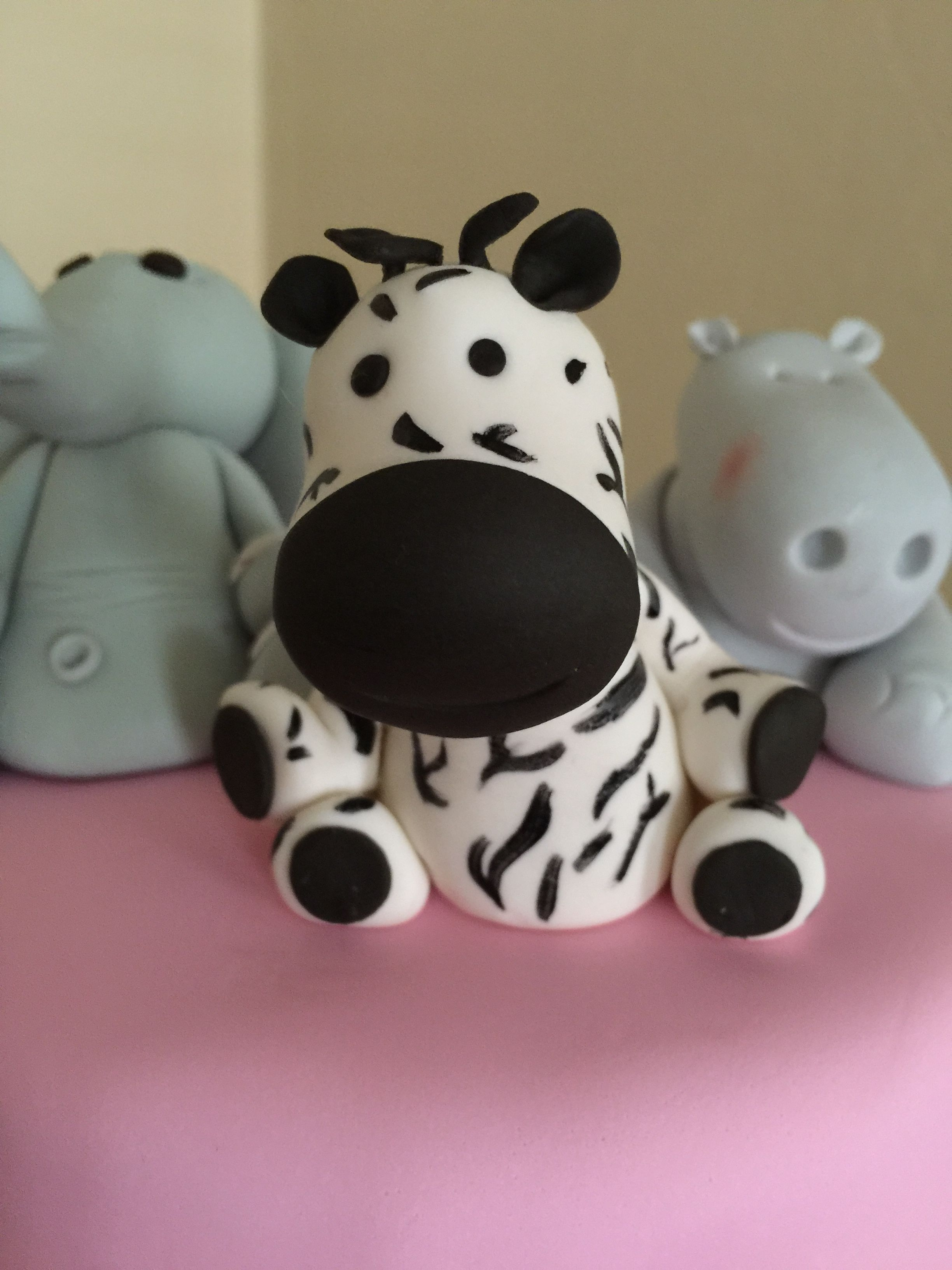 this was a zoo themed baby shower cake for a girl that works at the