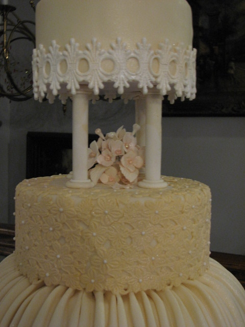 4 Tier Victorian Influence Wedding Cake In Ivory With Ruching And Lace Accents - CakeCentral.com