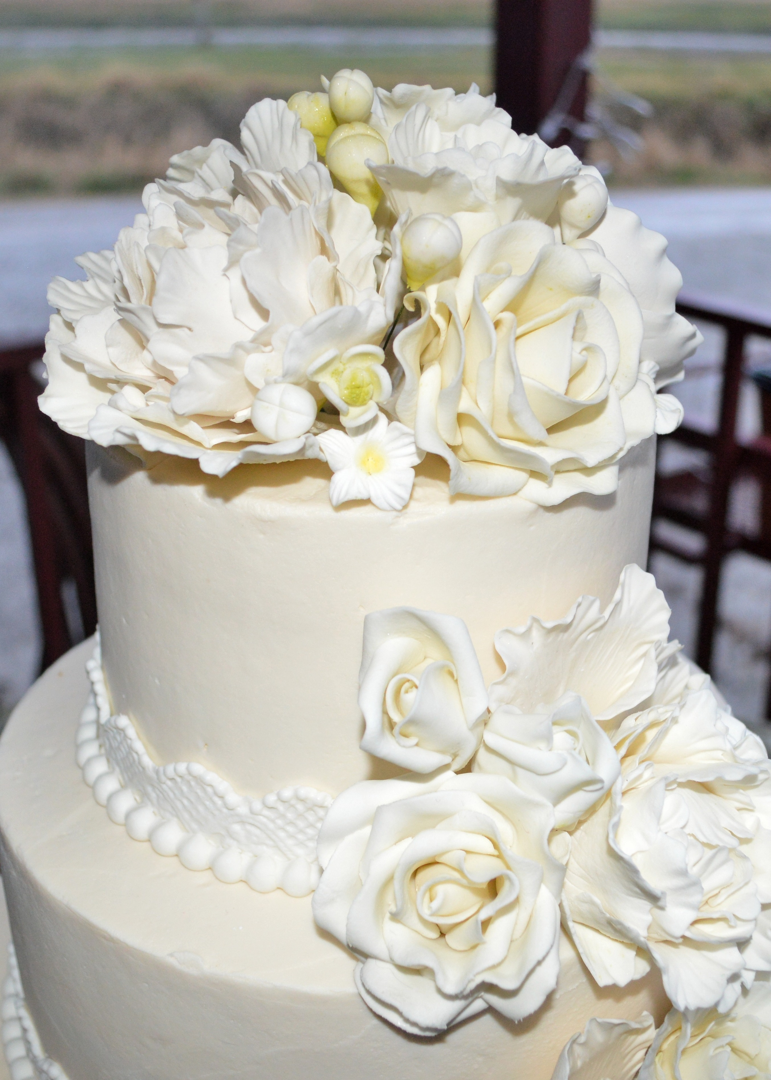 Buttercream Wedding Cake With Fondant Lace Trim And