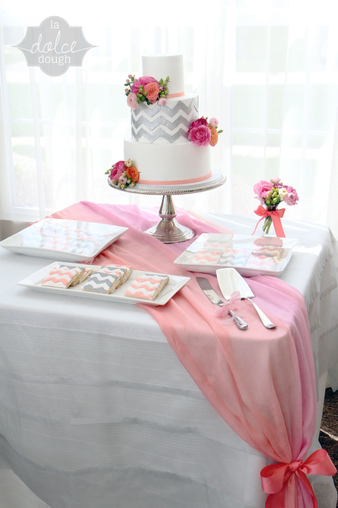 Coral pink and silver chevron bridal shower cake all Bridal shower table decorations
