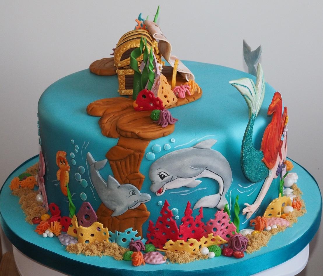 My daughter wanted a cake with ariel dolphins and a for Ariel cakes decoration