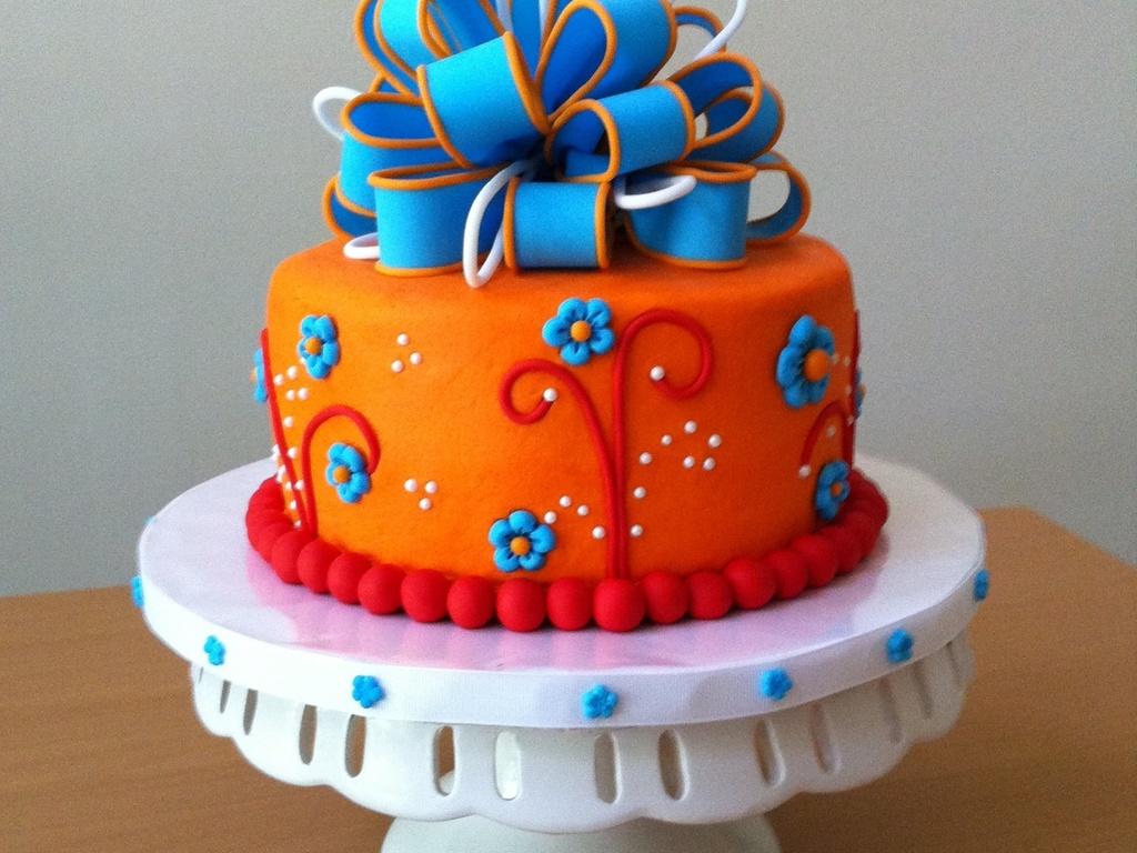 1024x768_597483XdFX_orange-and-blue-birthday-cake.jpg