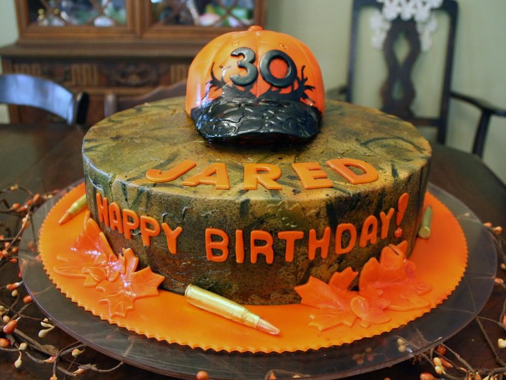 Camo And Orange Cakes
