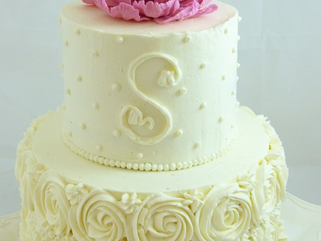 Buttercream Decorated Small Wedding Cake With Piped Roses Dots And A ...