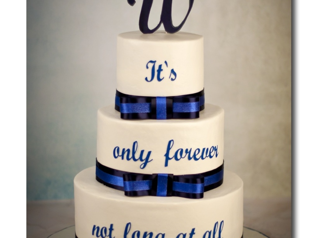 wedding cake using a quote from a favorite movie of the couple all