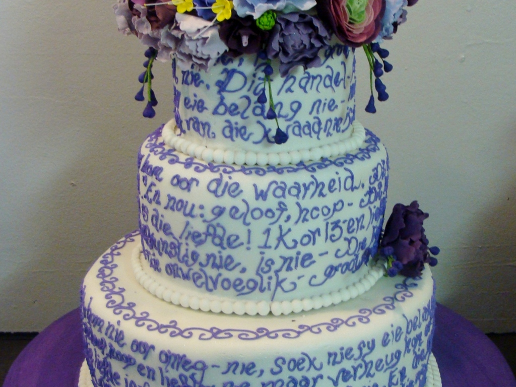 Purple and white wedding cake with flowers cakecentral mightylinksfo
