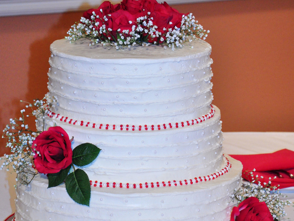 Wedding Cake With Rustic Buttercream Finish Pearls And Red Roses For Accents Cakecentral Com