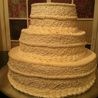 "Cornelli Lace Wedding Cake Small wedding cake (12"" 9"" & 6"" tiers), vanilla cake with raspberry filling and buttercream frosting, hand piped. They..."