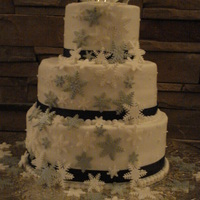 "Snowflake Wedding Cake Chocolate cake with mocha filling, 12"" 10"" and 6""."