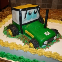 Tractor Cake A tractor Cake, tractor out of cake, fondant, wheels were made out of rice crispy treats, all edible.