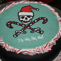 Christmas Pirate BCT over fondant with candy cane accents.
