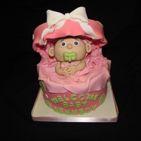 Gift Of A Baby! Baby Shower Cake-- Fondant baby made with cereal treats.