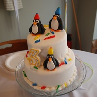 Penguin Cake Our daughter was really into penguins this year :) Fondant characters.