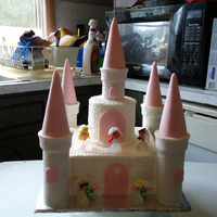 Disney Princess Castle  Disney Princess castle cake (gifted) for a 3 year old girl. All buttercream with fondant accents. Disney Princesses are dolls I bought....