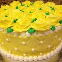 Yellow Roses Birthday Cake Buttercream roses. Impression matte used to emboss the buttercream on the sides of the cake.