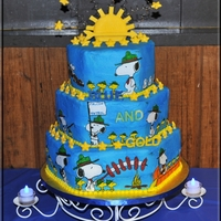 Cub Scouts Blue And Gold Cake Cake frosted with buttercream, then food color sprayed blue. I used the frosting sheets and drew Snoopy and Woodstock with edible food...