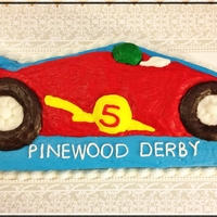 Pinewood Derby Car Cake This was the sheet type cake using a character pan that I made to go with the mini car cakes for this year's pinewood derby.