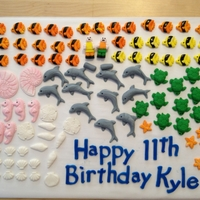 Fondant Pieces molded out of fondant: fish, sea horses, star fish, dolphins, turtles, shells, etc and lego people (for divers). These are what I've...