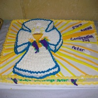 Peter's Confirmation Cake Full sheet cake, 1/2 chocolate, 1/2 yellow with Extra Specail Buttercream Frosting. Cross cake was cut from separate cake.