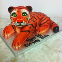 Tiger Cub His eyes, ears and nose are fondant. His whiskers were white craft wire. Everything else is cake and buttercream icing. The orange was...