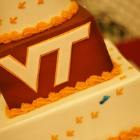 Hokie Wedding Close-up of Hokie/VT wedding cake. The groom is also a Tarheel fan.Buttercream icing with a fondant VT logo.