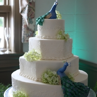 Peacock Wedding Original design by Flora Aghababyan. The tiers are buttercream icing and the peacocks are a 50/50 mix of fondant and gumpaste.