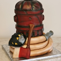Firefighter's Groom's Cake The helmet, axe and hose nozzle are RKT. Everything else is cake.